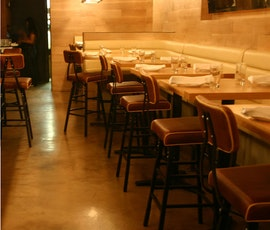 The warm earth tones of the resurfaced concrete floor add to the overall atmosphere of this upscale restaurant. (thumbnail)