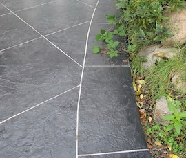A stampable concrete overlay beautifies this residential patio. (thumbnail)