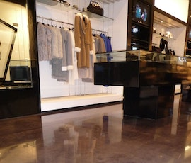 Retailers such as this clothing store appreciate the super high gloss shine polished concrete offers. (thumbnail)