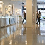 Image 4 of the polished concrete floor in the Alex and Ani flagship retail jewelry store in Providence, RI. The polished concrete was installed over a gypsum-based underlayment using Skraffino from Duraamen.