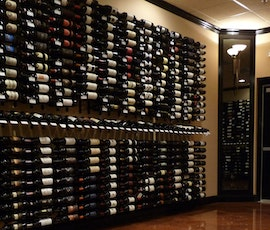 This wine store's merchandise shines thanks to Duraamen's Lumiere metallic epoxy flooring. (thumbnail)