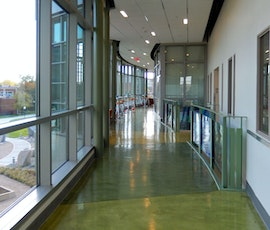 This hallway had it's flooring resurfaced in a multi-color scheme that fits the buildings interior design at Southern Connecticut State University (SCSU). (thumbnail)