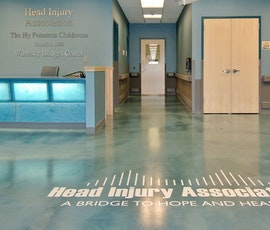 The logo of the head injury medical center appears on the metallic epoxy flooring. (thumbnail)