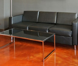 The glass table in this chiropractic office lobby fits nicely with the metallic epoxy flooring. (thumbnail)