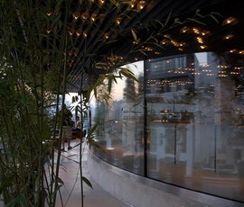 The flooring is a concrete microtopping / skimcoat from Duraamen. It fits perfectly with the plant decor and glass walls in this ultra-modern restaurant. (thumbnail)
