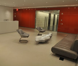 The modern concrete flooring at the offices of a New York City financial consulting firm, (thumbnail)
