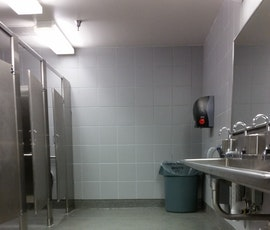 Kwortz flooring by Duraamen is and ideal solution where moisture is an issue such as a public restroom. (thumbnail)
