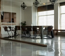 A view of the supper-sleek concrete micro topped floor in the conference room of JWT Dubai. (thumbnail)