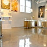 Image 8 of the polished concrete floor in the Alex and Ani flagship retail jewelry store in Providence, RI. The polished concrete was installed over a gypsum-based underlayment using Skraffino from Duraamen.