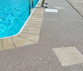 The area around this pool has been resurfaced with Duraamen's Uberdek, an exterior concrete resurfacing product. (thumbnail)