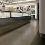 """Polished concrete floor in the Tiffany & Co. """"pop-up"""" store in NYC. Aisle near sales desks."""