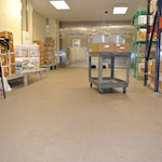 The decorative quartz flooring used in this commercial kitchen looks great from all sides. (thumbnail)