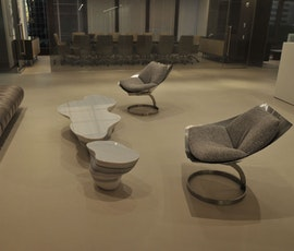 This contemporary, designer office furniture looks great on the resurfaced concrete floor created with Duraamen products. (thumbnail)