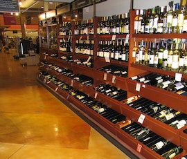 The wine section of Heinen's stained with shades of tan and orange, sealed with water based epoxy and polyurethane.  (thumbnail)