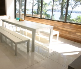 The light color of the concrete overlay floor opens up the space, particularly on a sunny day. (thumbnail)