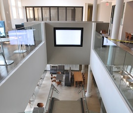 The resurfaced concrete floor carries onto the staircase that's featured in the middle of this office space. (thumbnail)