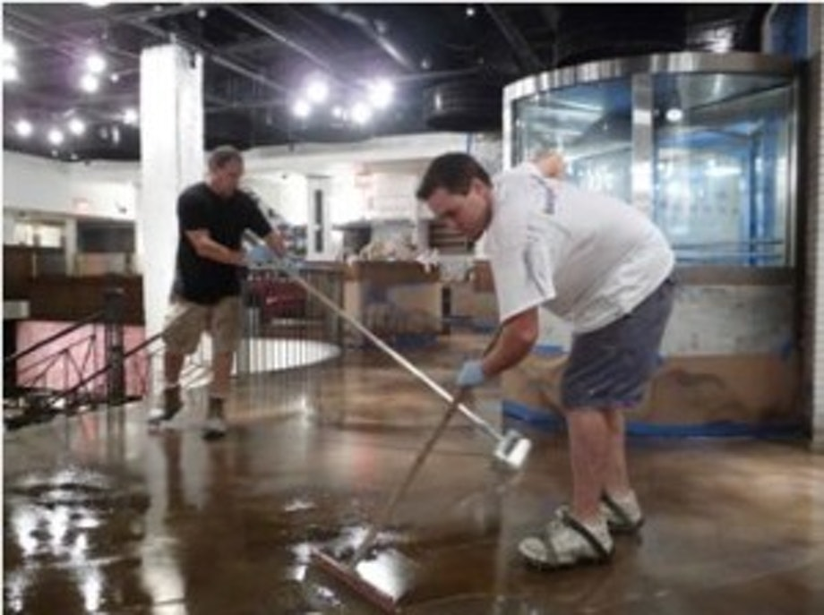 Installers applying a polyaspartic floor coating