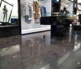 Merchandise in this clothing store looks spectacular hung above the high gloss floor. (thumbnail)