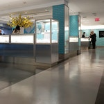 """Polished concrete floor in the Tiffany & Co. """"pop-up"""" store in NYC. An aisle on the sales floor."""