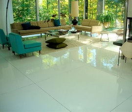 Residential living ares benefit from the modern style and easy maintenance of resinous flooring. (thumbnail)