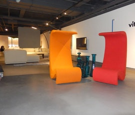 Bright colors juxtaposed against the subtle grey resurfaced concrete floor give life to the gallery's collection. (thumbnail)