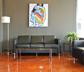 Metallic epoxy flooring provides a high-end feel, perfect for the lobby of this chirpractic office. (thumbnail)
