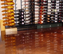Metallic epoxy flooring was the right choice for this high end wine store. (thumbnail)