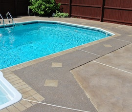 This slip resistant concrete walkway around this swimming pool was resurfaced with Uberdek. (thumbnail)