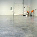 Installers applying an epoxy concrete floor coating. Duraamen's warehouse in Cranbury NJ.