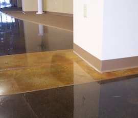 Concrete was ground and then subsequently colored with DESO dyes followed by water based epoxy sealer and solvent based polyurethane top coat.  (thumbnail)