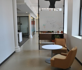 The casual lounge space sits atop another refinished concrete floor by Duraamen. (thumbnail)