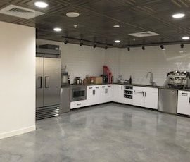 The kitchen has the same beautiful concrete floor as the rest of the shared office space. (thumbnail)