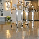 Image 1 of the polished concrete floor in the Alex and Ani flagship retail jewelry store in Providence, RI. The polished concrete was installed over a gypsum-based underlayment using Skraffino from Duraamen.
