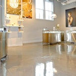 Image 7 of the polished concrete floor in the Alex and Ani flagship retail jewelry store in Providence, RI. The polished concrete was installed over a gypsum-based underlayment using Skraffino from Duraamen.