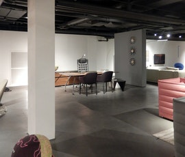 The gallery retailers space comes to life with the modern concrete flooring. (thumbnail)