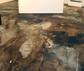 The deep browns, grays and blacks of the floor let the artwork stand out. (thumbnail)