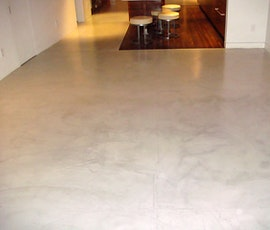 This residence utilizes resurfaced concrete floors in the appearance marble or stone. (thumbnail)