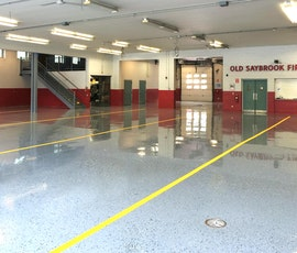This Firehouse in Saybrook, CT had Duraamen's Kwortz flooring system installed. The installation used a double broadcast of quartz granules. Don Pinger of Custom Concrete Solutions recognizes the high quality and durability of Duraamen products, which is why he chose Kwortz for the job. (thumbnail)