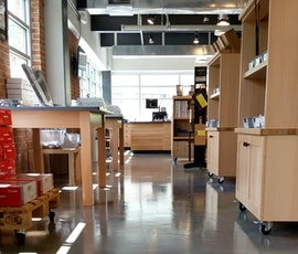 The modern high-end feel of the Wusthof Cutlery retail store demanded high-end, decorative concrete flooring like the metallic epoxy shown here. (thumbnail)