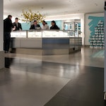 """Polished concrete floor in the Tiffany & Co. """"pop-up"""" store in NYC. A sales desk. The floor uses Düraamen's sprayable concrete microtopping for polished concrete."""