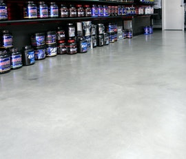 Upon close inspection, subtle monochromatic colors in the concrete flooring can be seen. Concrete dyes were used on a newly installed concrete overlay to achieve this effect. (thumbnail)
