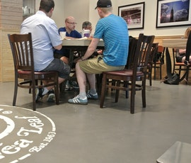 This resurfaced concrete floor can withstand the elements and heavy traffic of a NYC coffee shop.  (thumbnail)