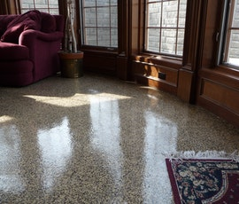 The natural light from these windows showoff the elegant shine of this basement floor. (thumbnail)