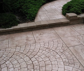 Stampable concrete overlays can produce many patterns like brick shown here. (thumbnail)