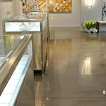 Image 5 of the polished concrete floor in the Alex and Ani flagship retail jewelry store in Providence, RI. The polished concrete was installed over a gypsum-based underlayment using Skraffino from Duraamen.