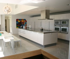 Another view of the residential kitchen and it's beautiful concrete overlay flooring in Hampton, NY. (thumbnail)