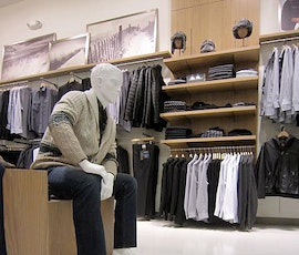 A maniquin admires the high-end concrete flooring solution at the Perri Ellis Outlet store. (thumbnail)