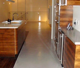 This kitchen has the look of marble flooring thanks to concrete resurfacing products from Duraamen. (thumbnail)