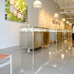 Image 9 of the polished concrete floor in the Alex and Ani flagship retail jewelry store in Providence, RI. The polished concrete was installed over a gypsum-based underlayment using Skraffino from Duraamen.