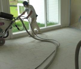 Metallic epoxy flooring decorates this art gallery. (thumbnail)